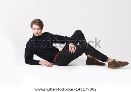 Fashion young men lying on the floor
