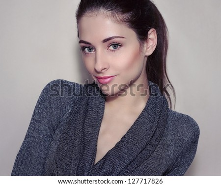 Fashion young model looking in modern dress. Closeup portrait - stock photo
