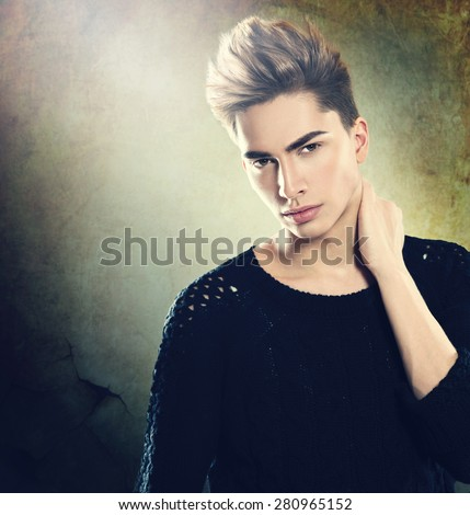 Fashion young model man portrait. Handsome Guy. Vogue style image of elegant young man. Hairstyle  - stock photo