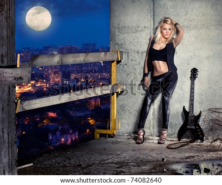 fashion young model to stay on the roof near wall - stock photo