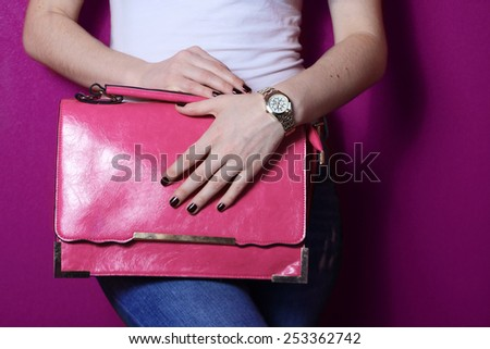 fashion young trendy girl hold big pink bag near purple wall - stock photo