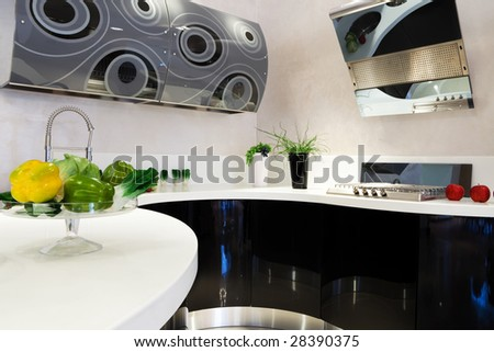 fashionable and beautiful kitchen in a modern apartment - stock photo