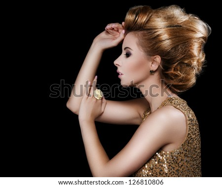 Fashionable attractive blonde hairdo on a black background - stock photo