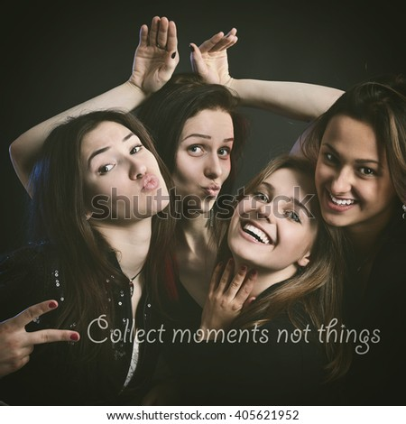 fashionable attractive happy party teen girls have fun with positive message, over black background - stock photo