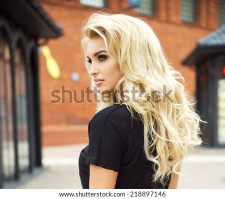 Fashionable beautiful blonde woman posing outdoor - stock photo