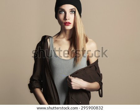 fashionable beautiful young woman in hat. beauty blond girl in cap. casual wear - stock photo
