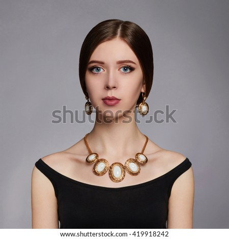 Fashionable beauty girl.Beautiful young woman in black dress.jewelry Accessories - stock photo
