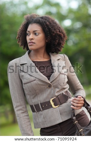 Fashionable black woman in the park - stock photo