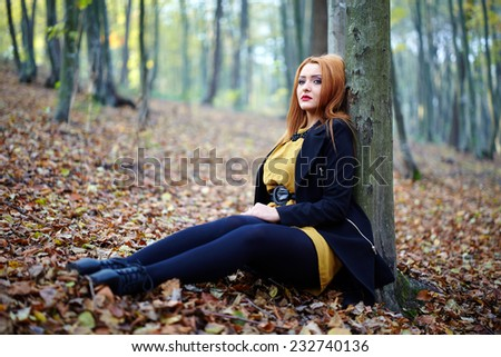 Fashionable blonde girl, outdoor portrait in the forest
