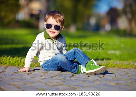 fashionable boy in spring park - stock photo