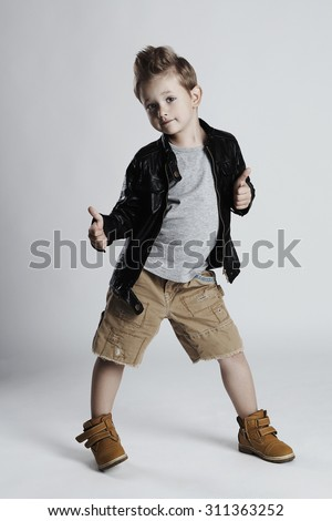 Fashionable child in leather coat.little boy hairstyle. Autumn fashion.funny smiling kid - stock photo