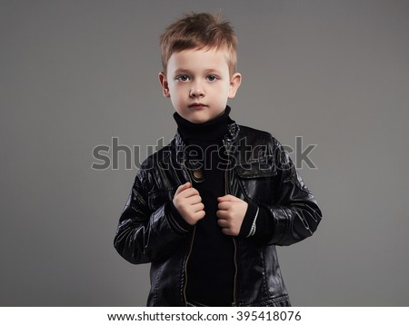 Fashionable child in leather coat.stylish little boy. spring fashion.funny 6 years old kid - stock photo