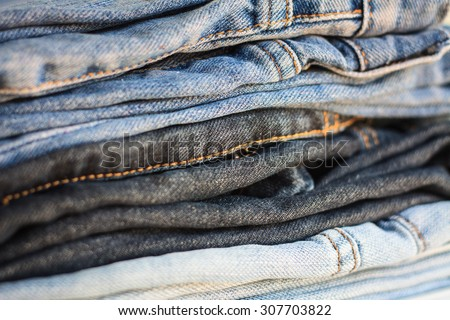 fashionable clothes, pile of jeans - stock photo
