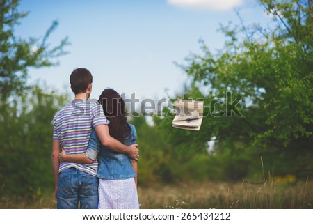 Fashionable cool couple stay back in park and flying book, lifestyle - concept