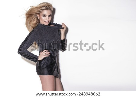 Fashionable elegant woman posing in studio. Girl with long hair. - stock photo