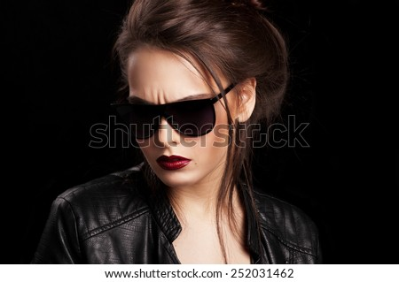 Fashionable girl in glasses.