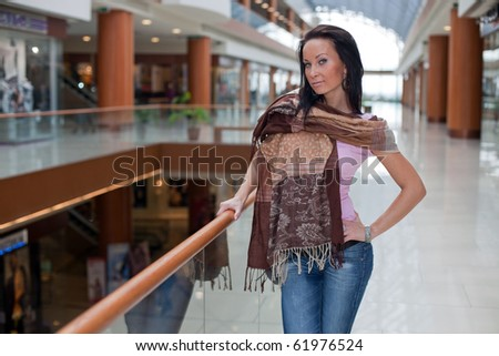 Fashionable girl over the mall background - stock photo