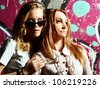 fashionable girls in sunglasses - stock photo