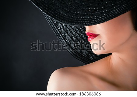 fashionable glamorous woman in hat closeup  - stock photo