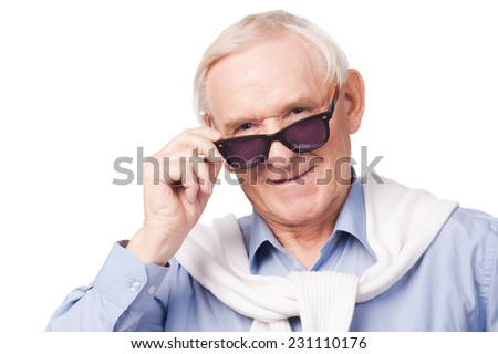 Fashionable grandfather. Stylish senior man wearing sunglasses and looking at camera while standing against white background  - stock photo