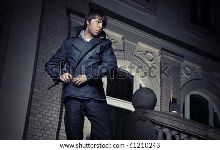 Fashionable guy wearing jeans jacket - stock photo