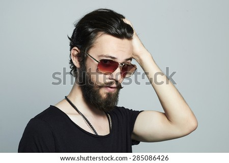 fashionable handsome man. Brutal bearded Sexy boy in trendy sunglasses