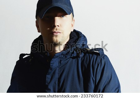 Fashionable Handsome Man in cap. Stylish Boy with Blue Eyes. Casual Winter Fashion - stock photo
