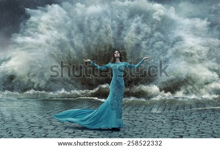 Fashionable lady on the sea storm - stock photo