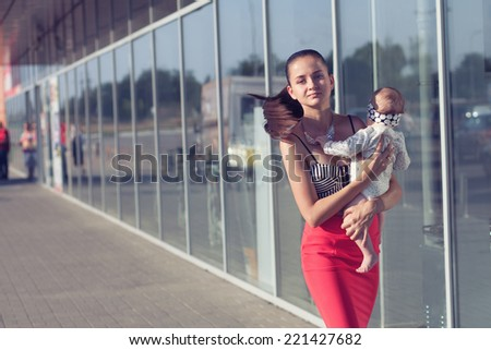 Fashionable mother - stock photo