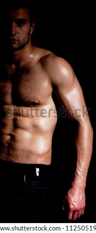 Fashionable muscular man in dark