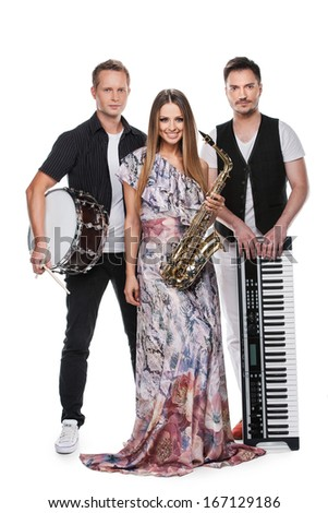 Fashionable music band posing full length over white background. Two handsome man and beautiful sexy woman with music instruments  - stock photo