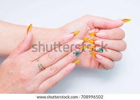 Fashionable Nail Design Amber Stilettos Artificial Stock Photo