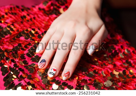 Fashionable nails with vegas symbol - stock photo