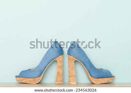 Fashionable Peeptoe High Heels on blue background - stock photo