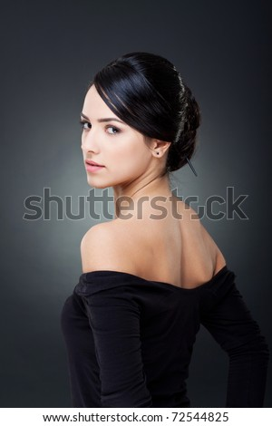 Fashionable photo of elegant girl with nice hairstyle - stock photo