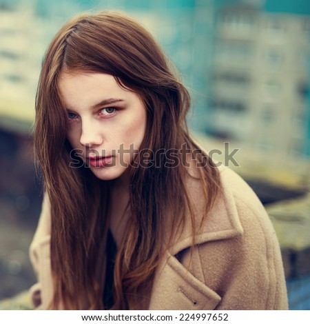 Fashionable portrait of a beautiful autumn girl hipster roof - stock photo