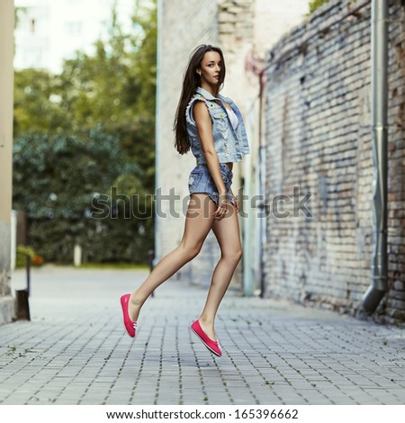 Fashionable portrait of a beautiful girl in jump - stock photo