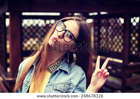Fashionable portrait of a beautiful hipster girl. Denim stylish clothes. Glamorous Lady fashion trends.  - stock photo