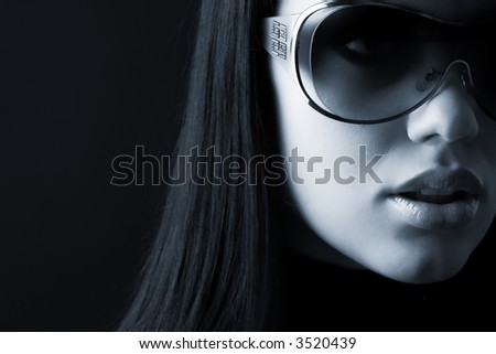 fashionable portrait of gitl in glasses in low key - stock photo