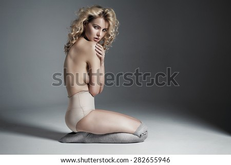 Fashionable shot of slim blond woman
