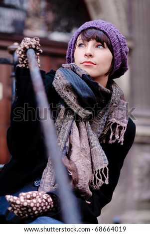 fashionable single young woman wearing violet clothes - stock photo