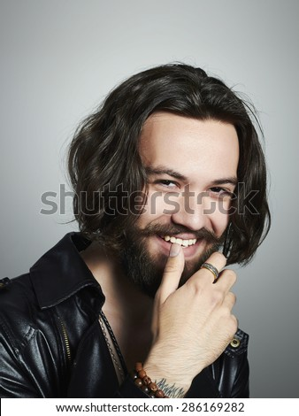 fashionable smiling handsome man. Brutal bearded Sexy boy - stock photo