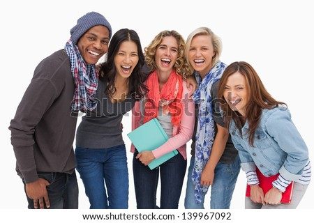 Fashionable students in a row smiling on white background - stock photo