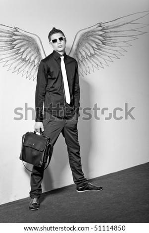 Fashionable stylish man in angel - stock photo