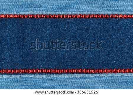 Fashionable  texture,  jeans and red  rhinestones, with space for your text