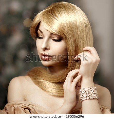 Fashionable trendy young woman with luxurious hair. Beautiful girl with long hair. Blonde with shiny hairstyle. - stock photo