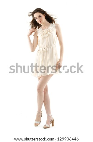 fashionable woman in modern dress posing - series of photos - stock photo