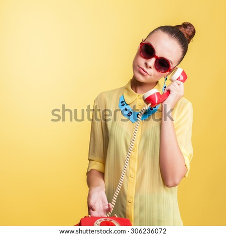 fashionable woman in sunglasses with phone in hand