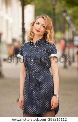 Fashionable woman in vintage dress on the streets. Summer photo - stock photo