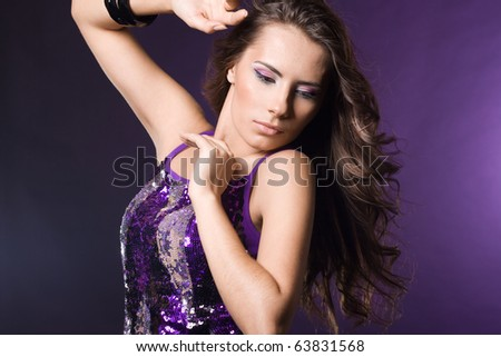 fashionable woman in violet dress
